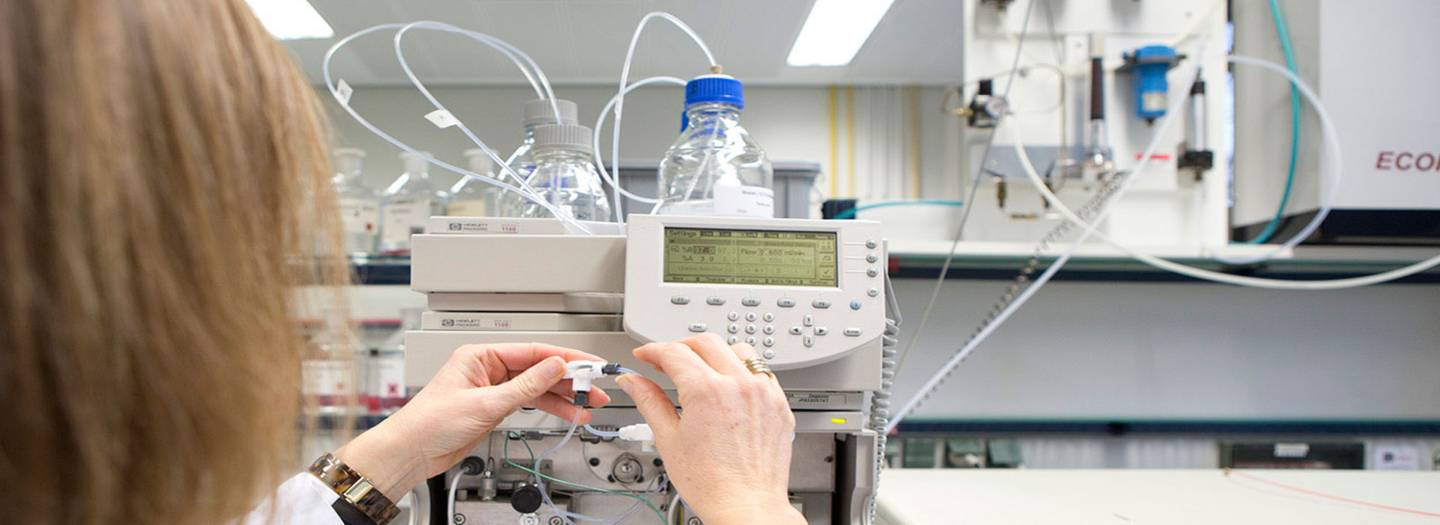 Researcher working with a medical device.