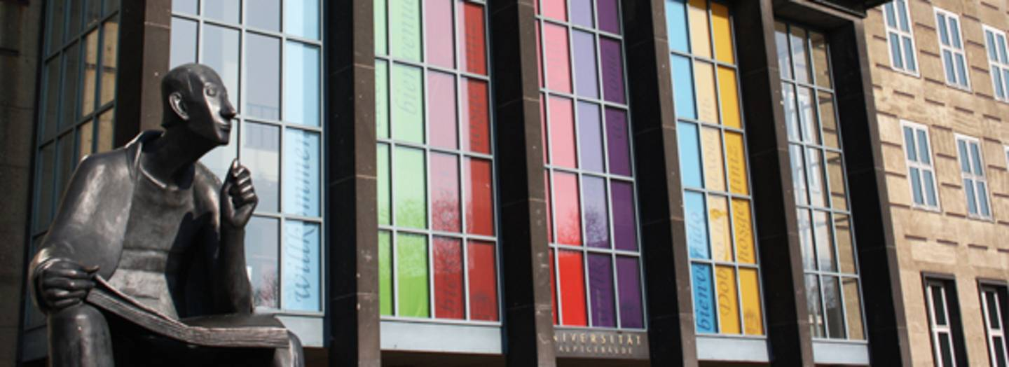 The colorfully decorated windows on the Main Building next to the Albertus Magnus Statue.