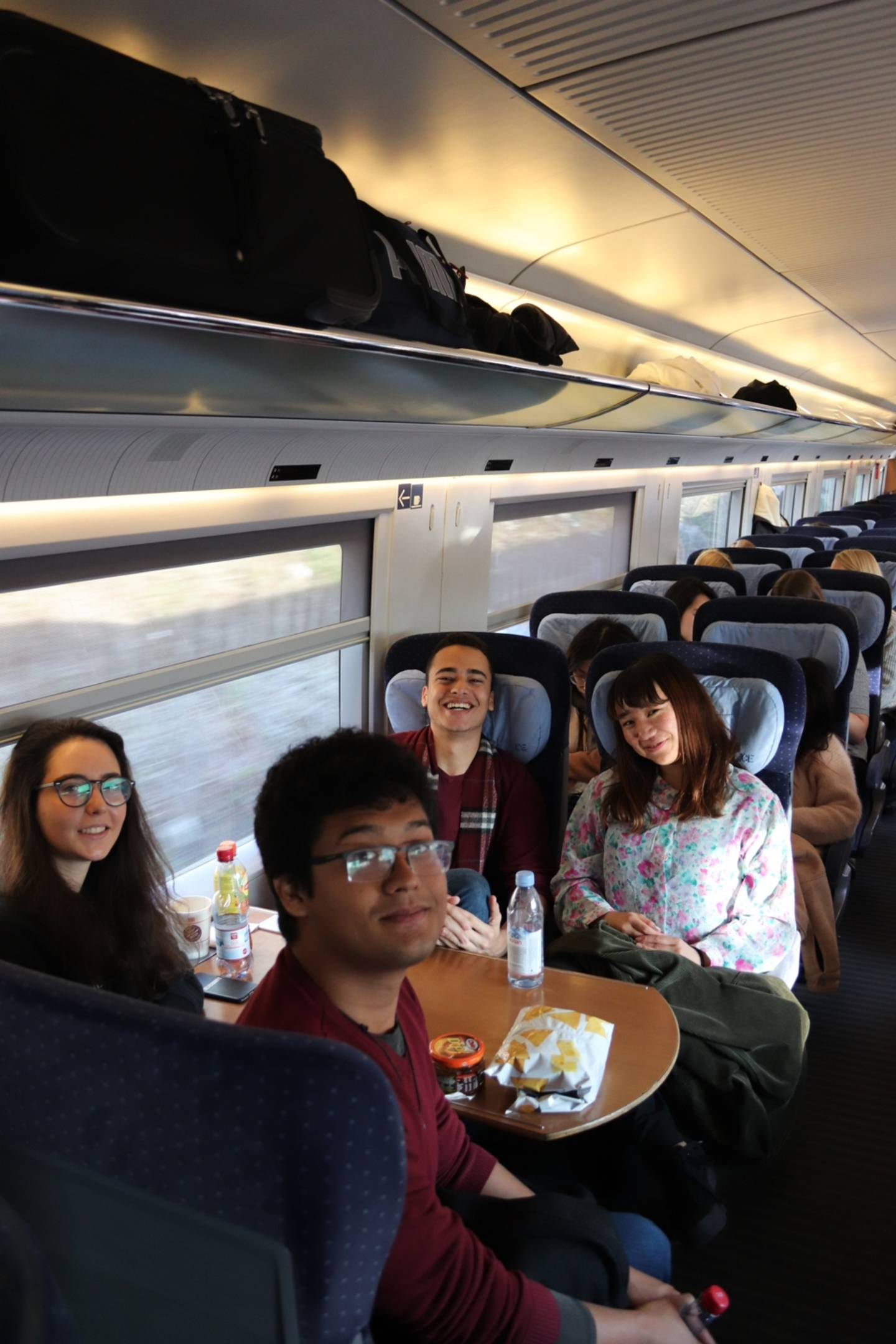 Students sitting in the train to Brussels