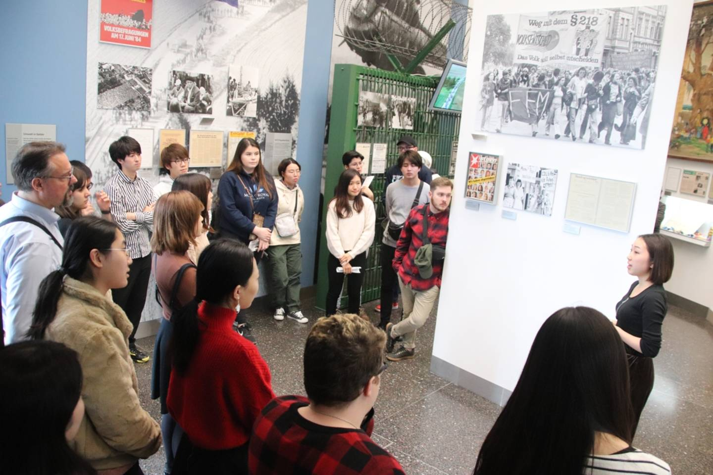 Group of students listening to the guide in the Haus der Geschichte.