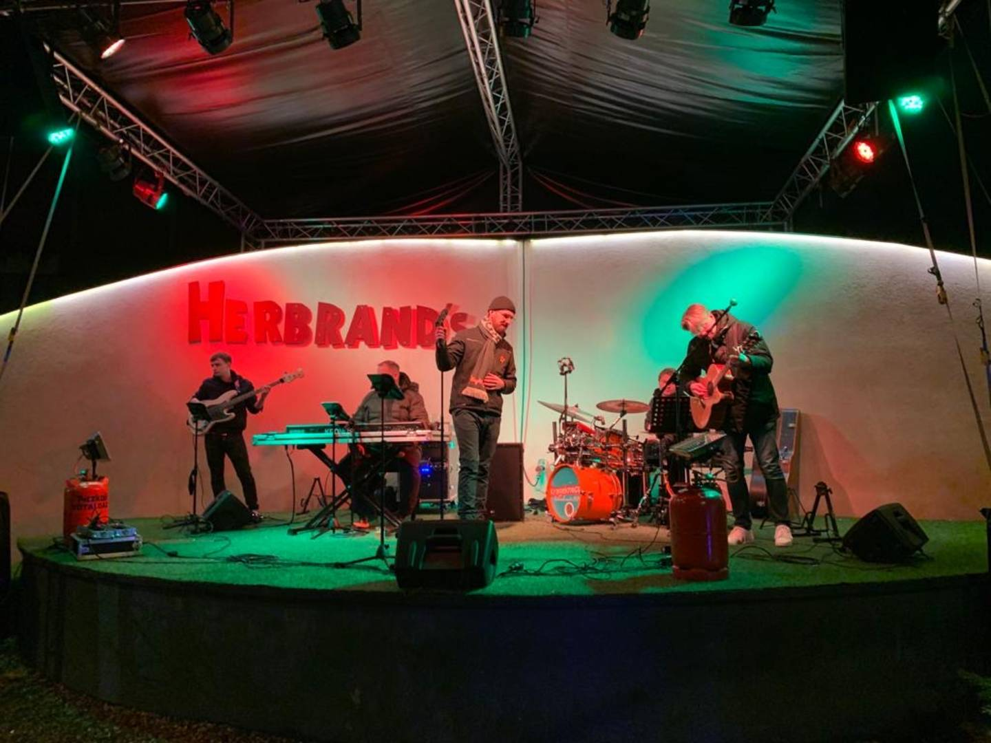 Music band performing on a stage