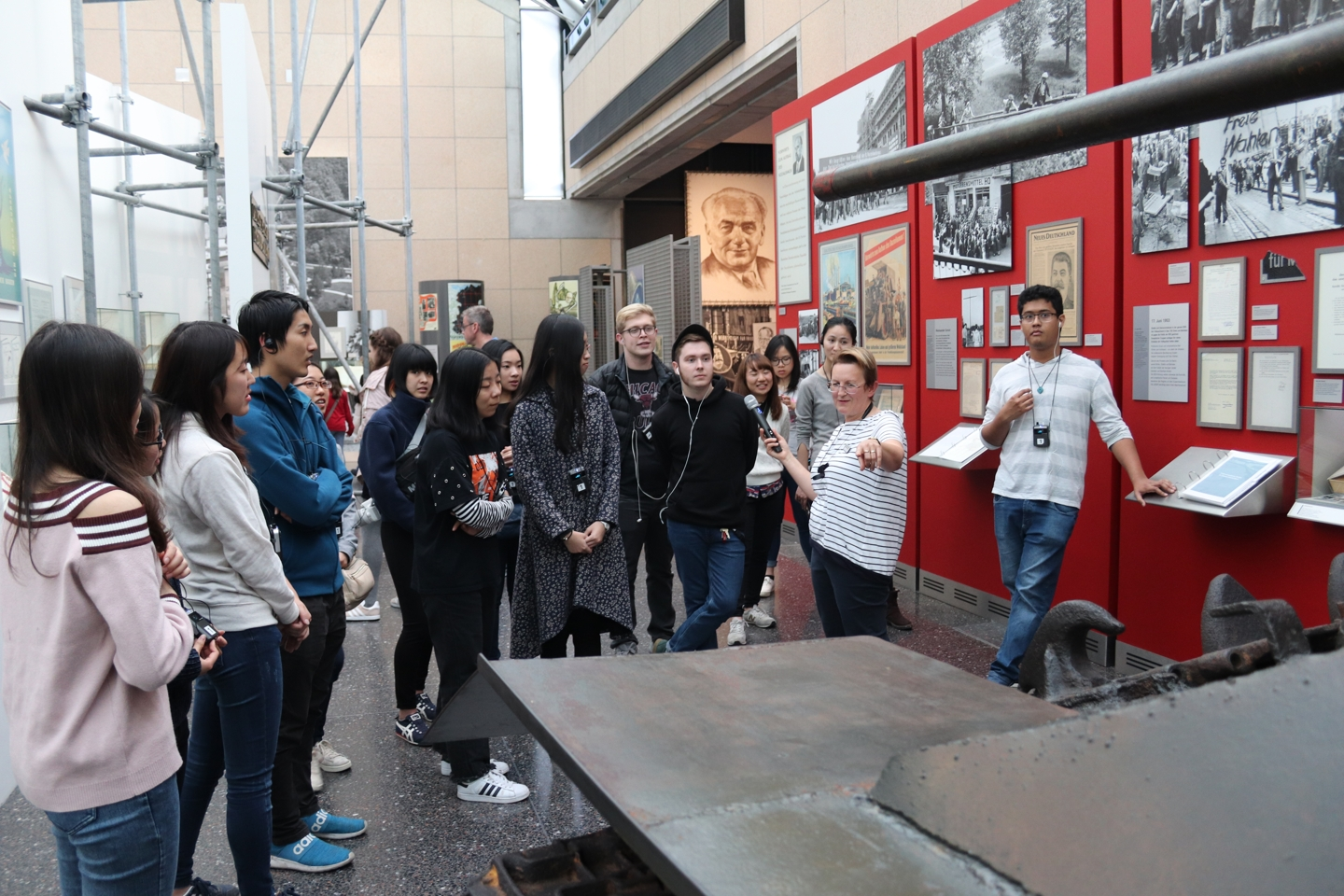 Students listening to the museum guide