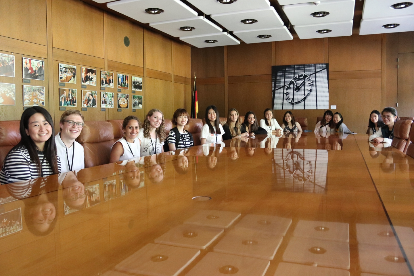 Group of students sitting at a big conference table