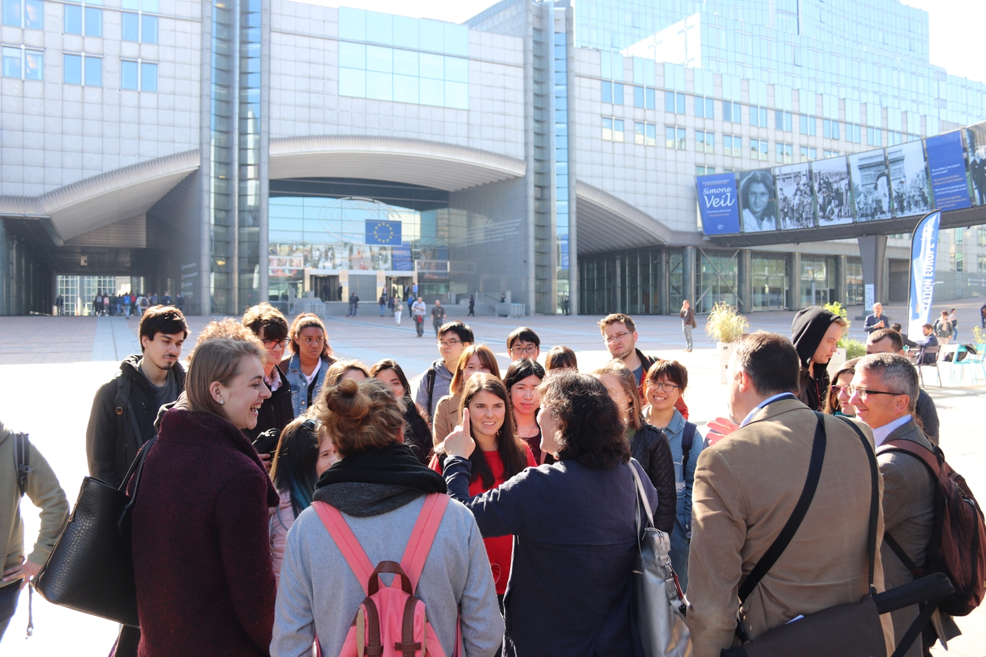 Students standing in front of the EU Parliament building