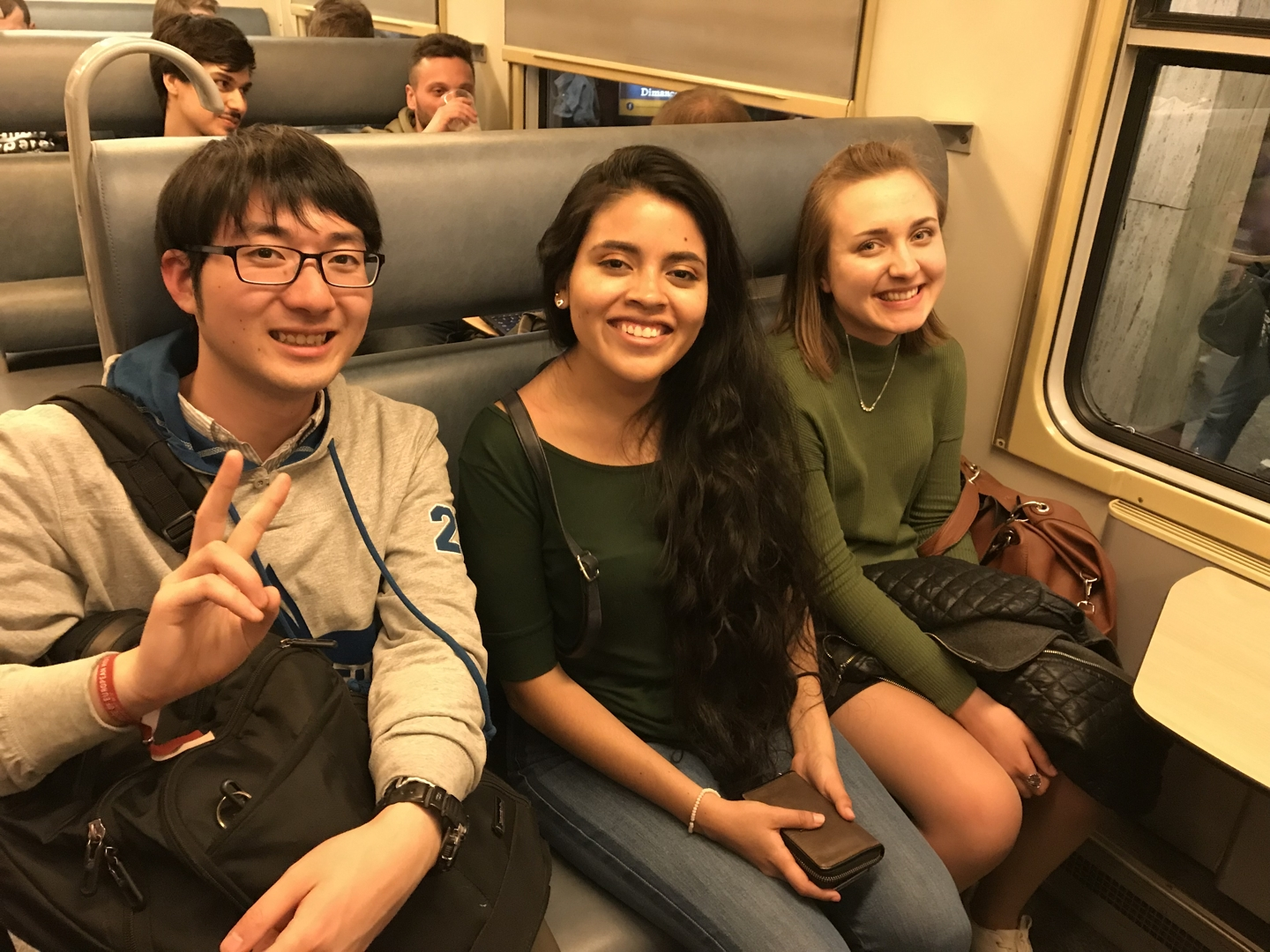 Three students in the subway of Brussels