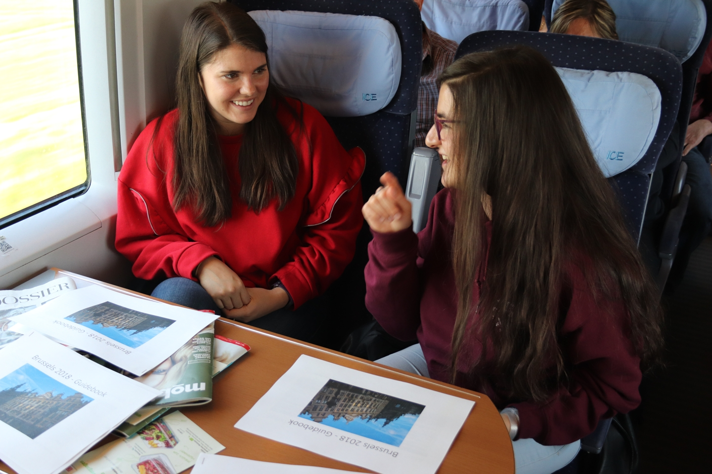 Two students talking in the train