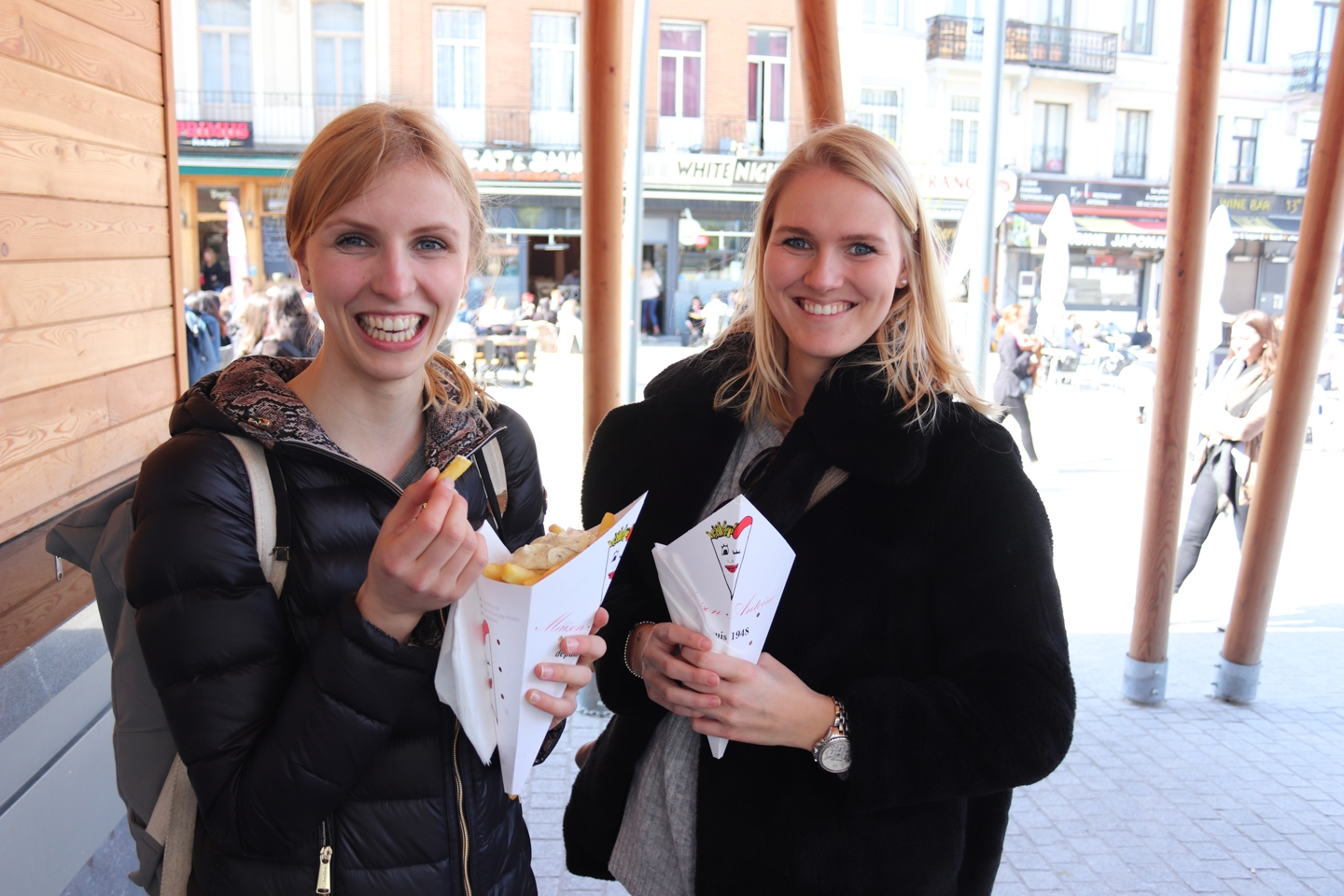 Two female students eating begian fries