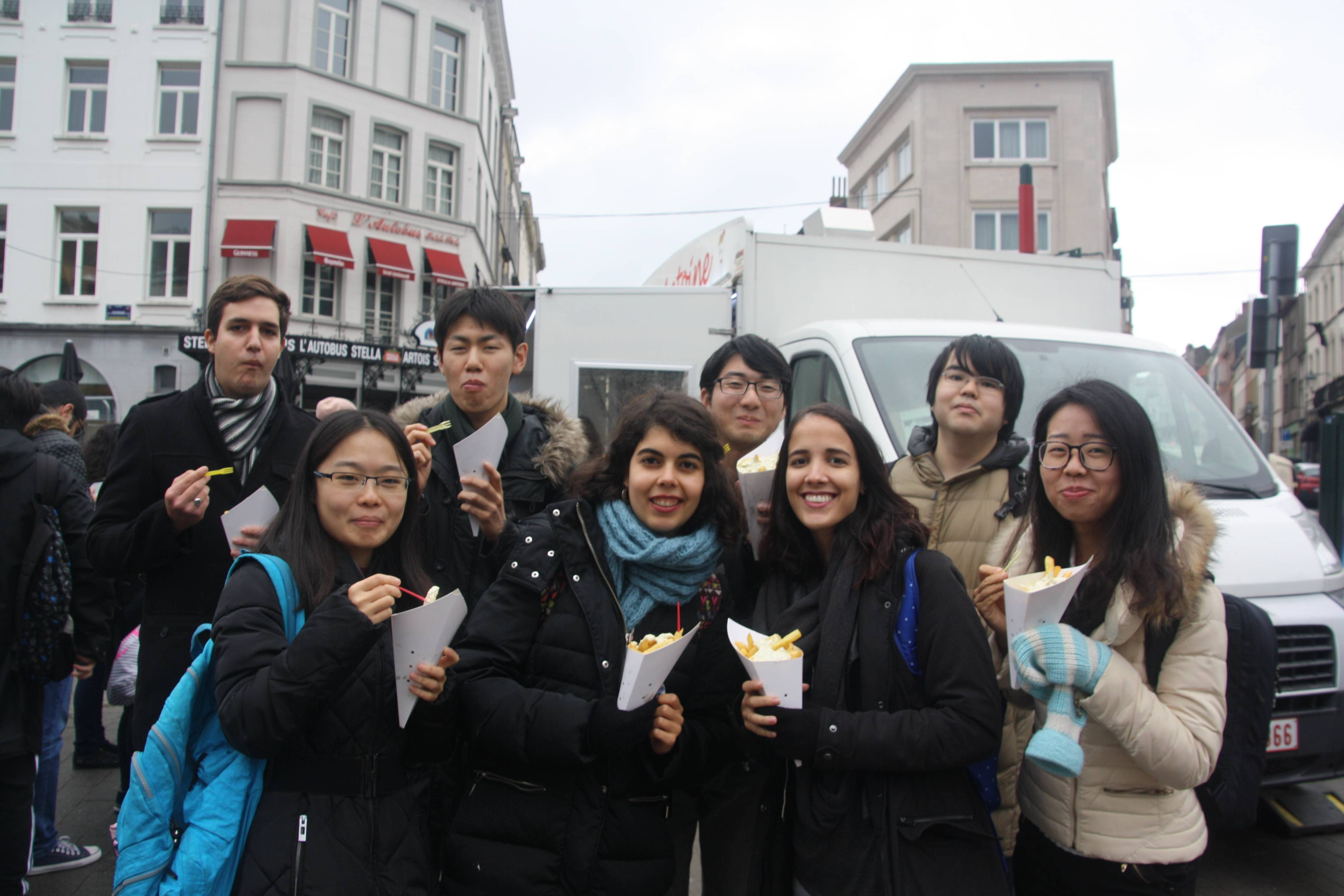 Students with bags of belgian fries in their hands