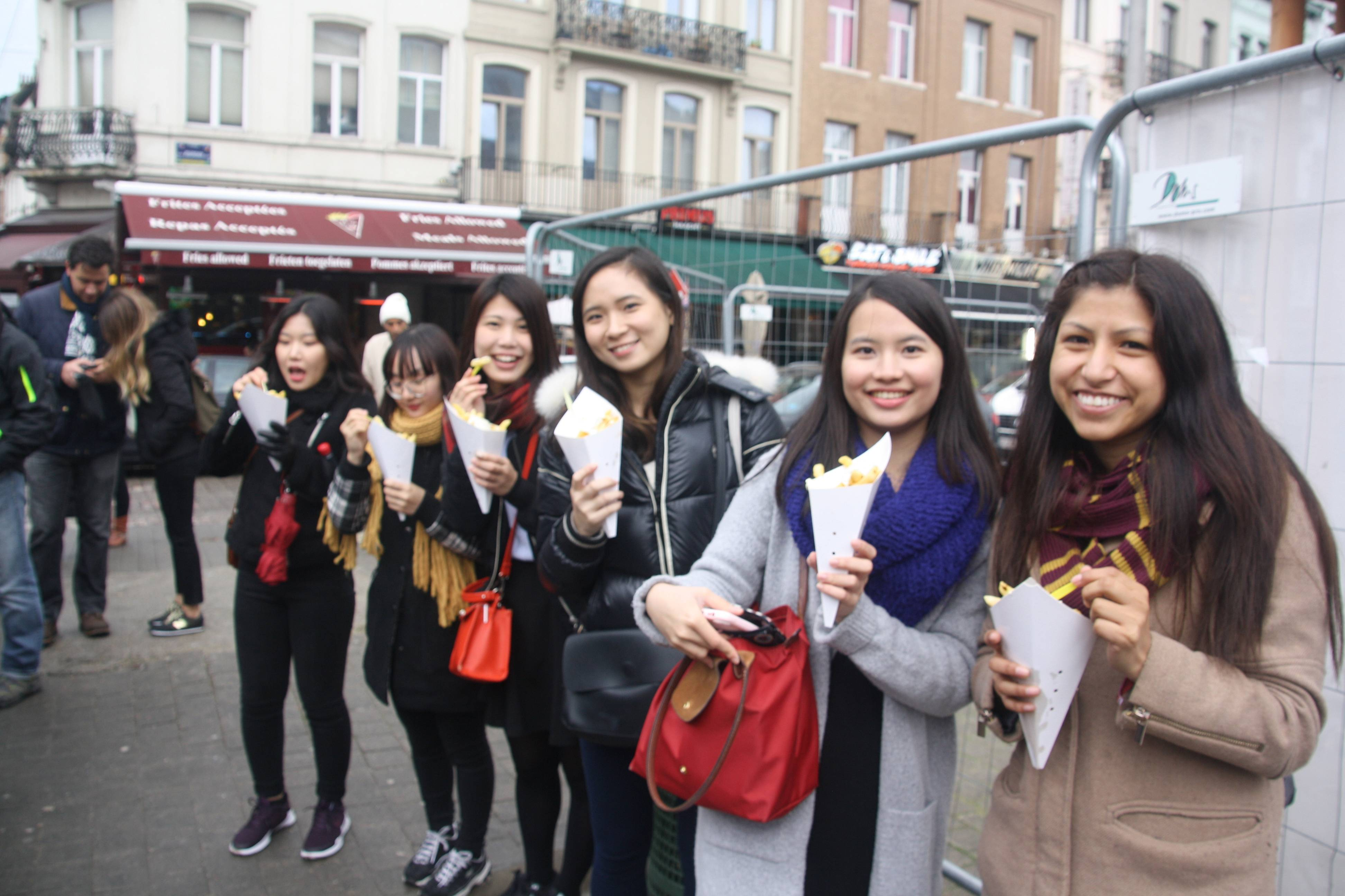 Six students with belgian fries