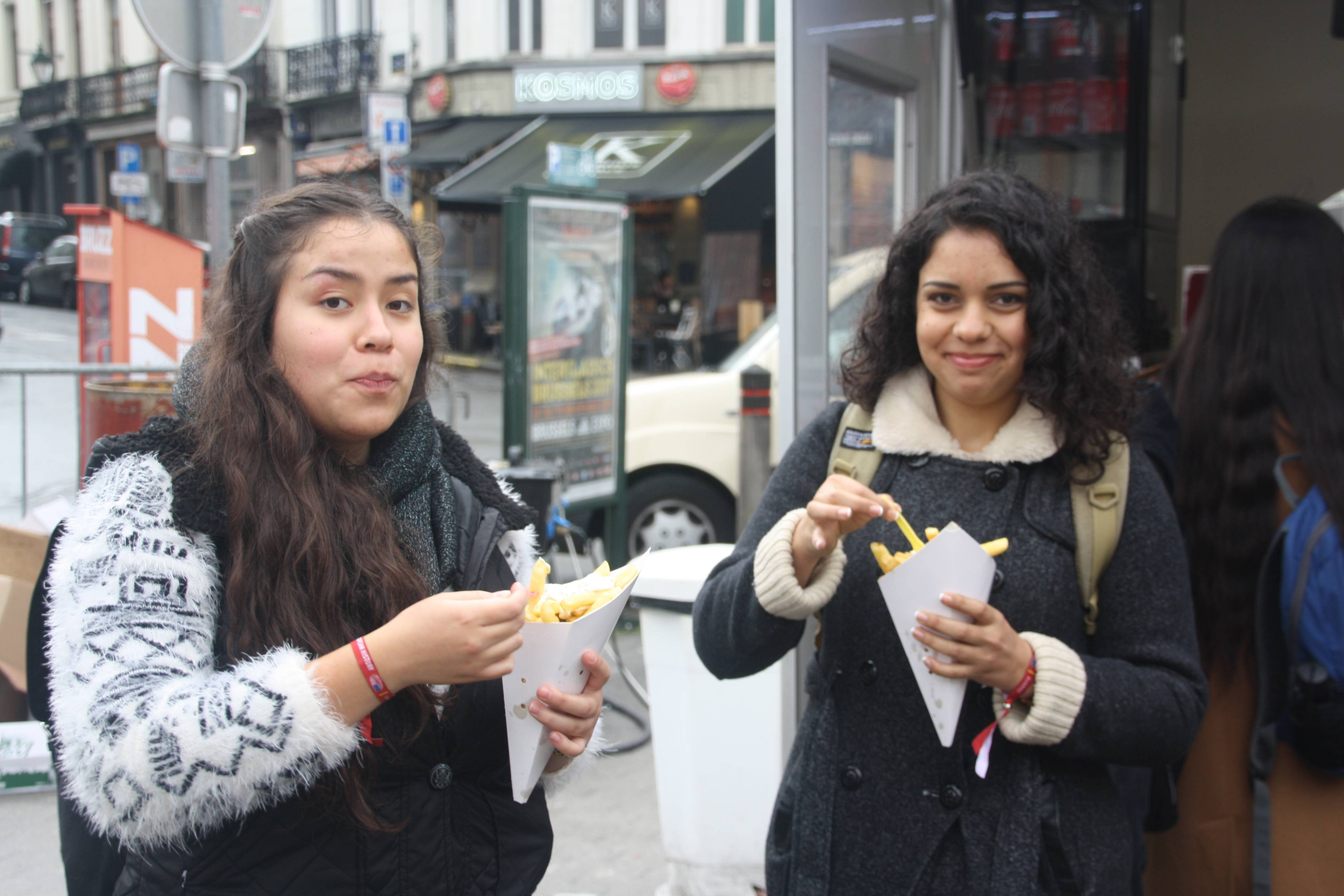 Two students about to eat belgian fries