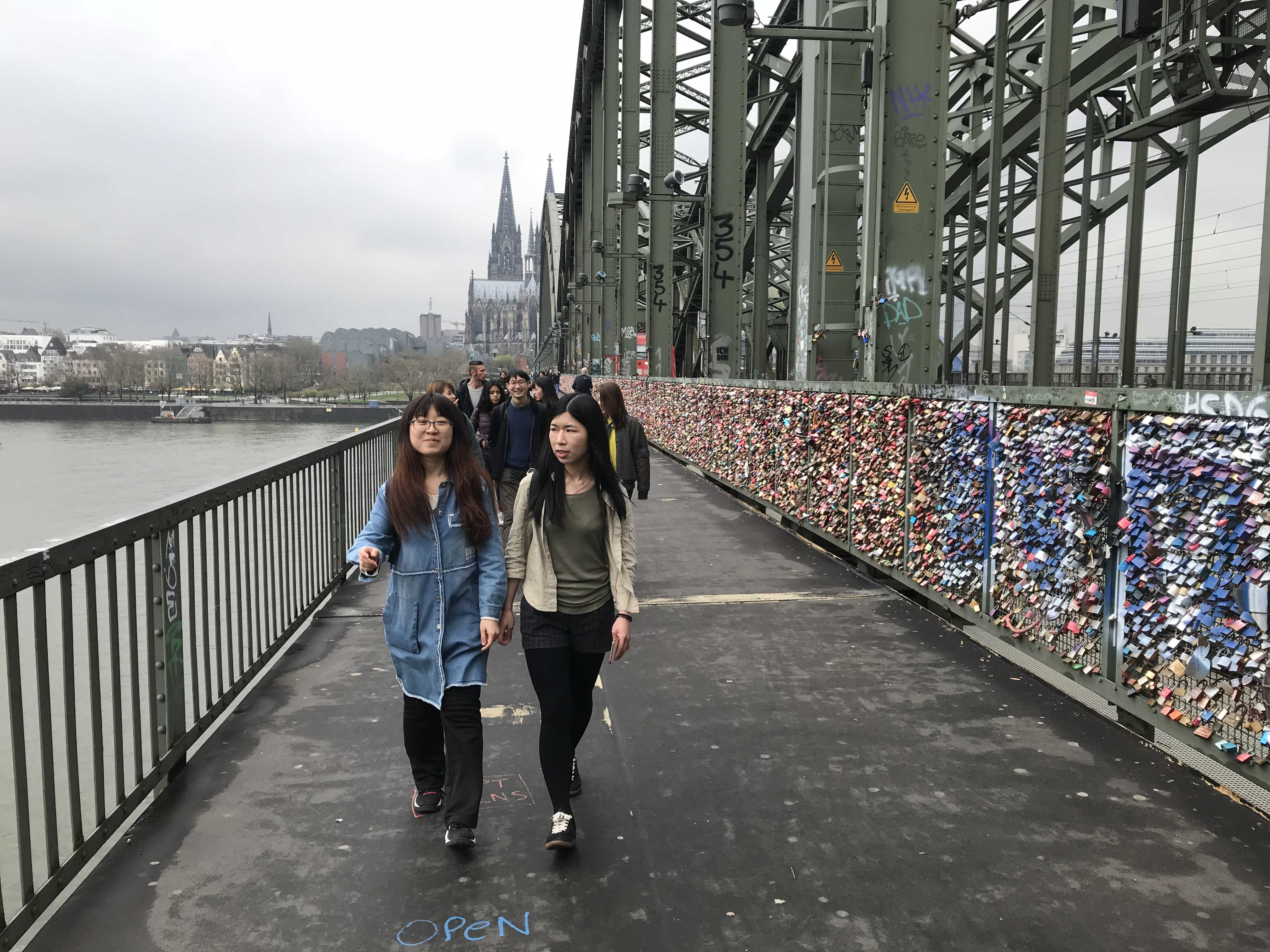 Students walking over the hohenzollern bridge