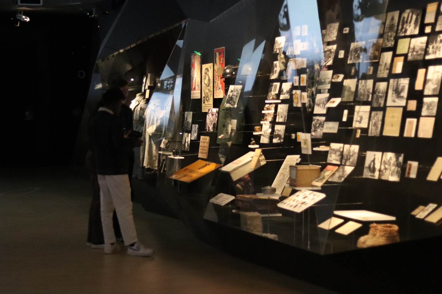 Part of the exhibition at a museum in Brussels. In the glass display are old pictures and posters.